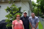 Todd, Bill Bratrud, and I in front of trees we got him in honor of the project.
